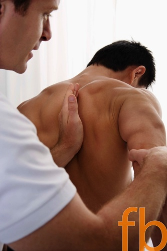 Patient receiving osteopathic treatment