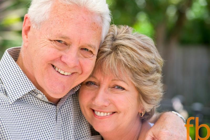 Senior couple smiling portrait outdoors